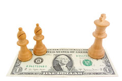 Chess and dollar: Light bishops and king on one US dollar bill. Light bishops and king on one US dollar bill Stock Photography
