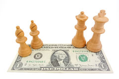 Chess and dollar: Light bishops on one US dollar billLight bishops, king and queen on one US dollar bill. Light bishops, king and queen on one US dollar bill Royalty Free Stock Photography