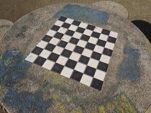 Chess or draught checker game board. Outdoor game board for playing draughts checkers or chesses stock photos
