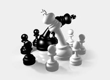 Chess Fight. Two groups of 3D chess pawns gathered around thier kings while they are fighting on a white reflective background Royalty Free Stock Images