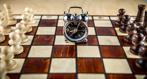 Chess fight and clock Royalty Free Stock Photography