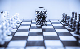 Chess fight and clock Stock Images