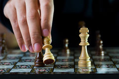 Chess. Fighting between brown and black army on chess board Stock Photo