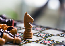 Chess. Fighting between brown and black army on chess board Stock Photography