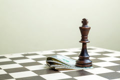 Chess figure the king with money Stock Photos