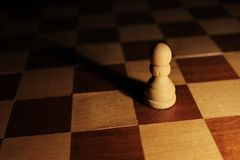 Chess. Figure (pawn) on ,,battlefield Stock Images