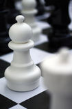 Chess figure - white pawn on outdoor chessboard. Street chess Royalty Free Stock Image
