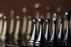 Chess figures. The photo shows the chessboard with metal figures Royalty Free Stock Images
