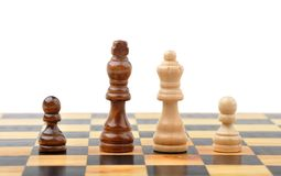 Chess figures as interracial family Royalty Free Stock Images