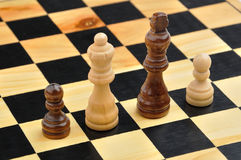 Chess figures as interracial family Royalty Free Stock Photo