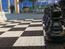 Chess figures big size board game background. Black chess figures concept strategy no people Stock Image