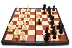 Chess figures on a board Stock Images