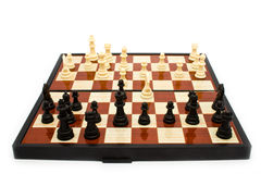 Chess figures on a board Royalty Free Stock Photos