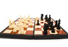 Chess figures on a board Stock Photography