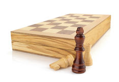 Chess figures and board isolated at white Royalty Free Stock Photo