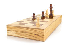 Chess figures and board isolated at white Stock Image