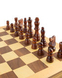 Chess figures on board at white Stock Image