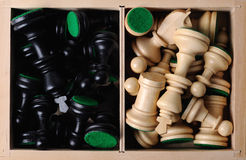 Chess figures in box. Black  and white wooden  Chess figures in box Royalty Free Stock Image