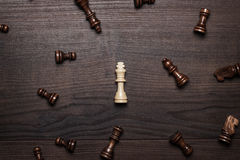Chess figures on the brown woden table concept Royalty Free Stock Image