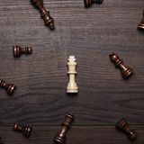 Chess figures on the brown woden table concept Stock Images