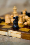 Chess figures on a chess board Stock Photography
