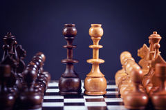 Chess figures on a chess board, symmetrically set Royalty Free Stock Photography