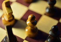 Chess figures on a chessboard Royalty Free Stock Photography