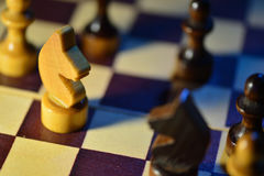 Chess figures on a chessboard Stock Photos