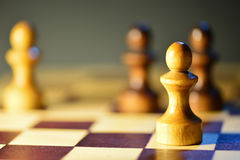 Chess figures on a chessboard Stock Photography
