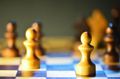 Chess figures on a chessboard Royalty Free Stock Image