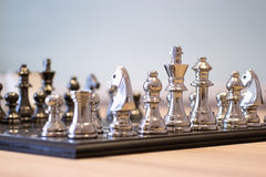 Chess figures on chessboard Stock Photos