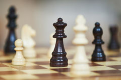Chess figures at chessboard Stock Image