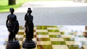 Old chess king and queen figures royalty free stock photo