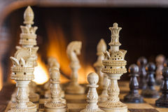 Chess Figures and the fire Background. A shot of chess figures in front of the fire Royalty Free Stock Image