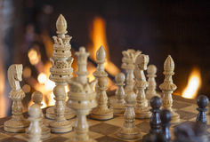 Chess Figures with Fireplace Background Stock Photography