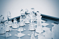 Chess figures in glass Royalty Free Stock Images