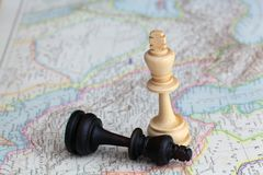 Chess figures. On a historical map royalty free stock photos