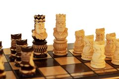 Chess figures isolated on white stock photography