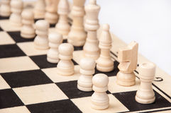Chess figures lined up on a chess board Royalty Free Stock Images