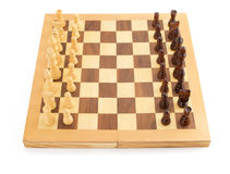 Chess Figures On Board At White Royalty Free Stock Photos