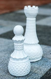 Chess figures outdoor. Royalty Free Stock Photo