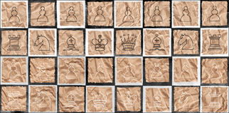 Chess figures on packaging paper Stock Photos