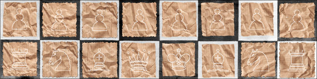 Chess figures on packaging paper Royalty Free Stock Photo