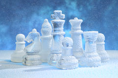 Chess figures under snow Stock Images