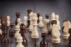 Chess figures on the wooden table Royalty Free Stock Photography