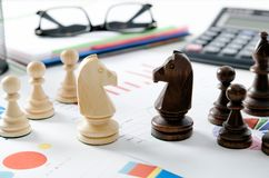 Chess financial business strategy. Financial business strategy. Chess on desk in office concept Stock Image