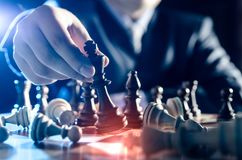 Chess financial, leader strategy in business. Chess financial business strategy concept. Team leader holding chess piece Stock Photography