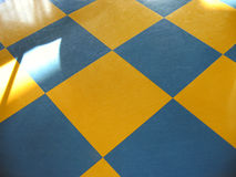 Chess floor. Old fashion chess floor with yellow and blue. Still has its charm Stock Photos