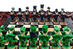 Chess in the form of military against prisoners on the board.  Stock Photography