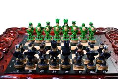 Chess in the form of military against prisoners on the board.  Royalty Free Stock Photo